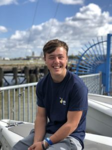 Boy Smiling sat on boat